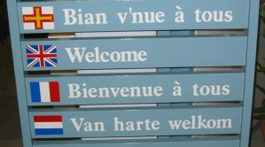 Welcome_multilingual_Guernsey_tourism-672x372